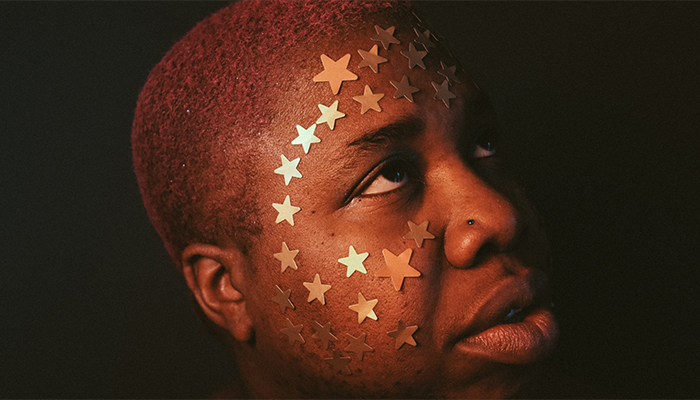 man with stars on face