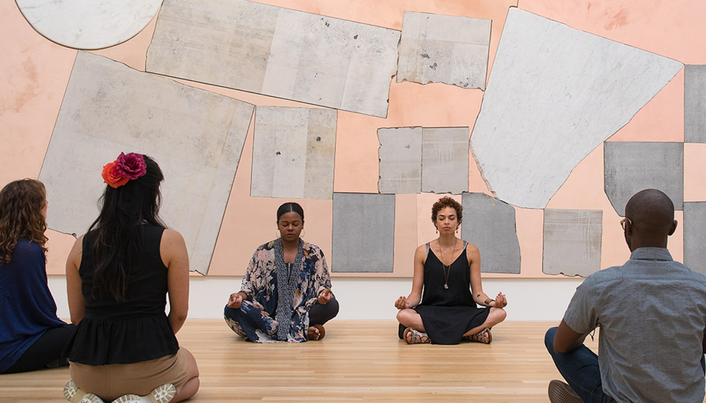 On Pause program image of people meditating in front of artwork