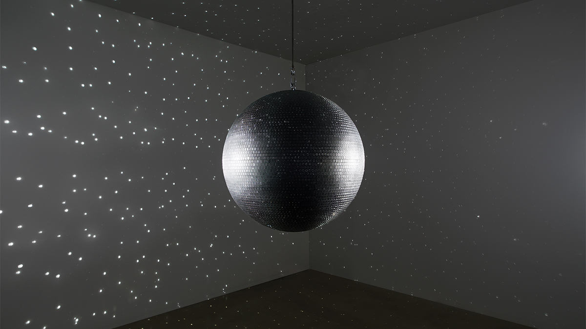 disco ball artwork casting light across a room