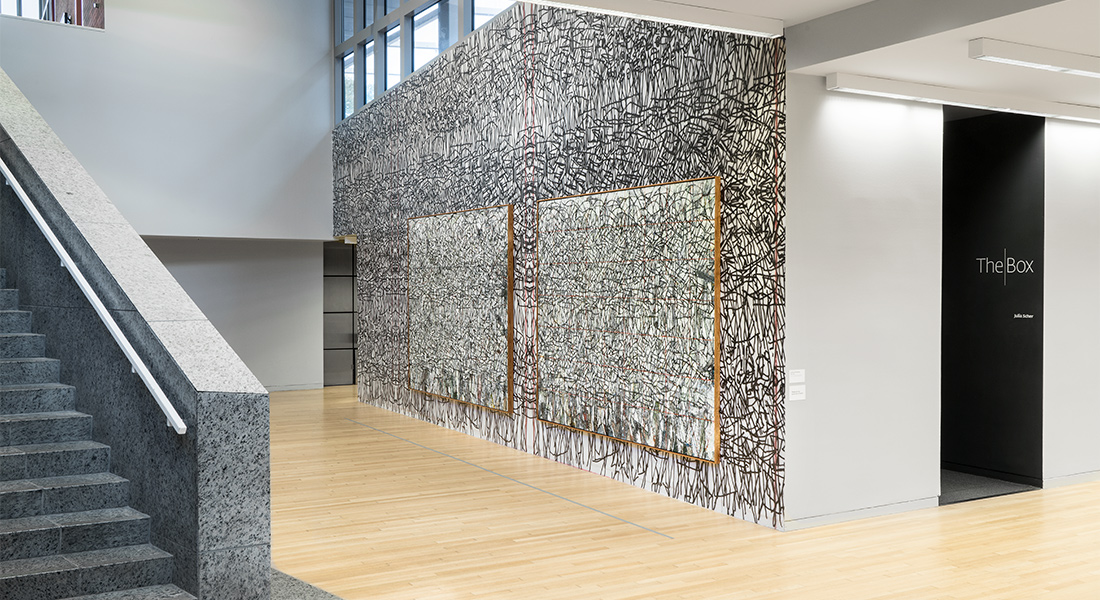 large wall installation by Zachary Armstrong in the Wexner Center lower lobby.