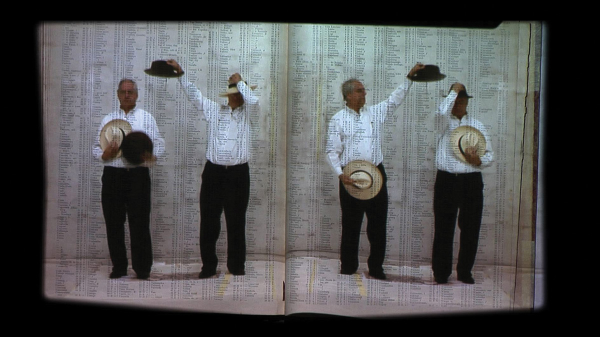 Detail of video installation showing Kentridge changing hats on four versions of himself