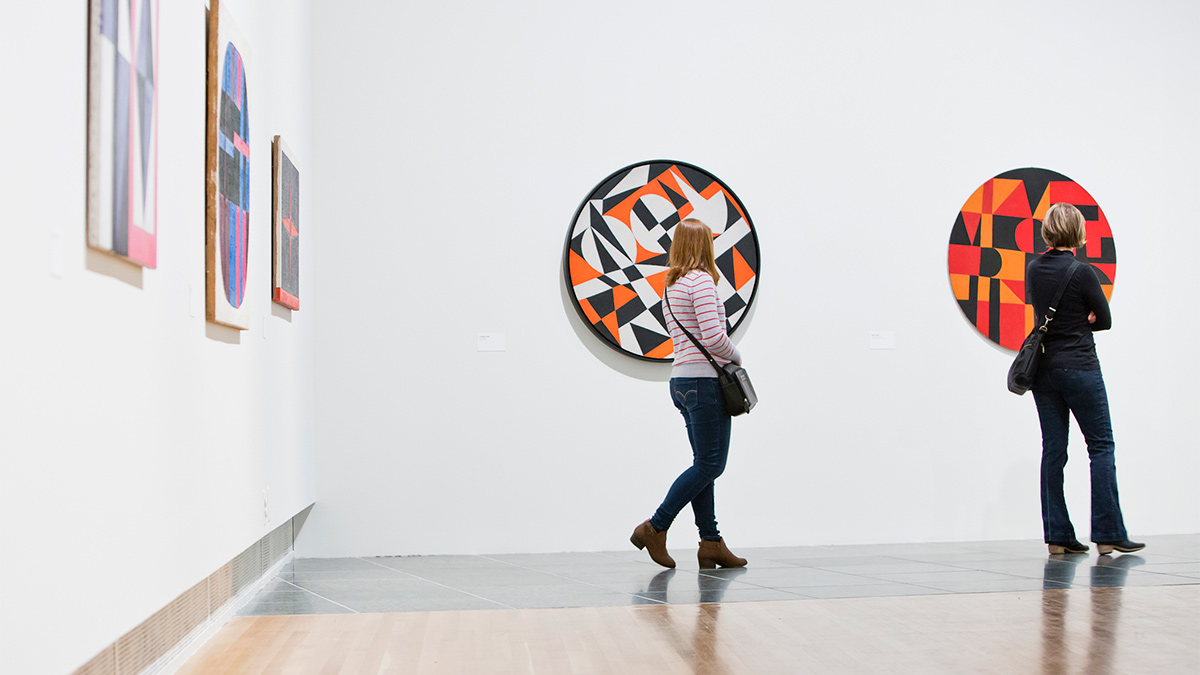Patrons viewing Carmen Herrera works in the Wexner Center galleries