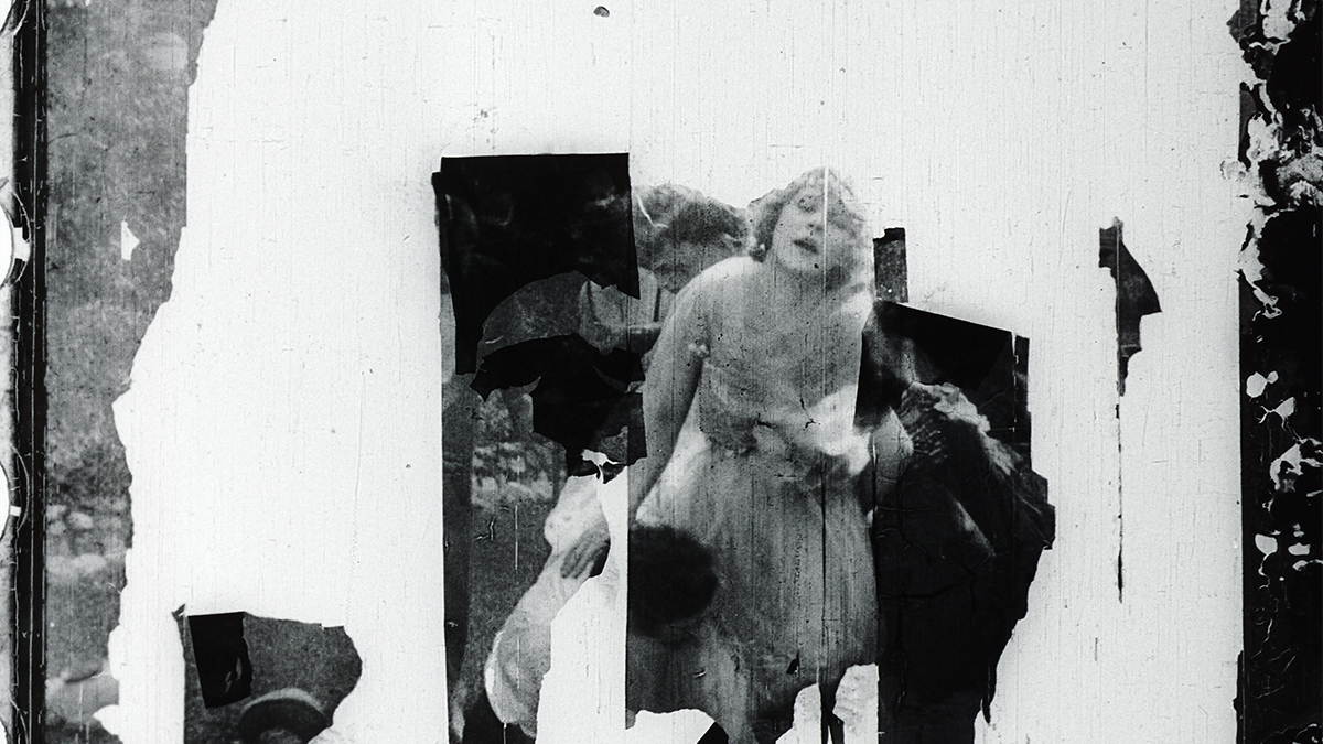 Film still of distorted image of a woman