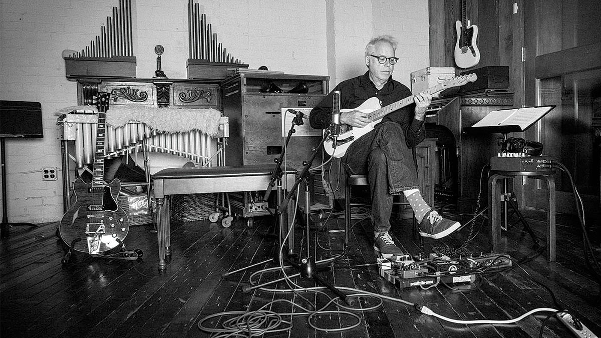 Black and white photo of Bill Frisell playing th Guitar