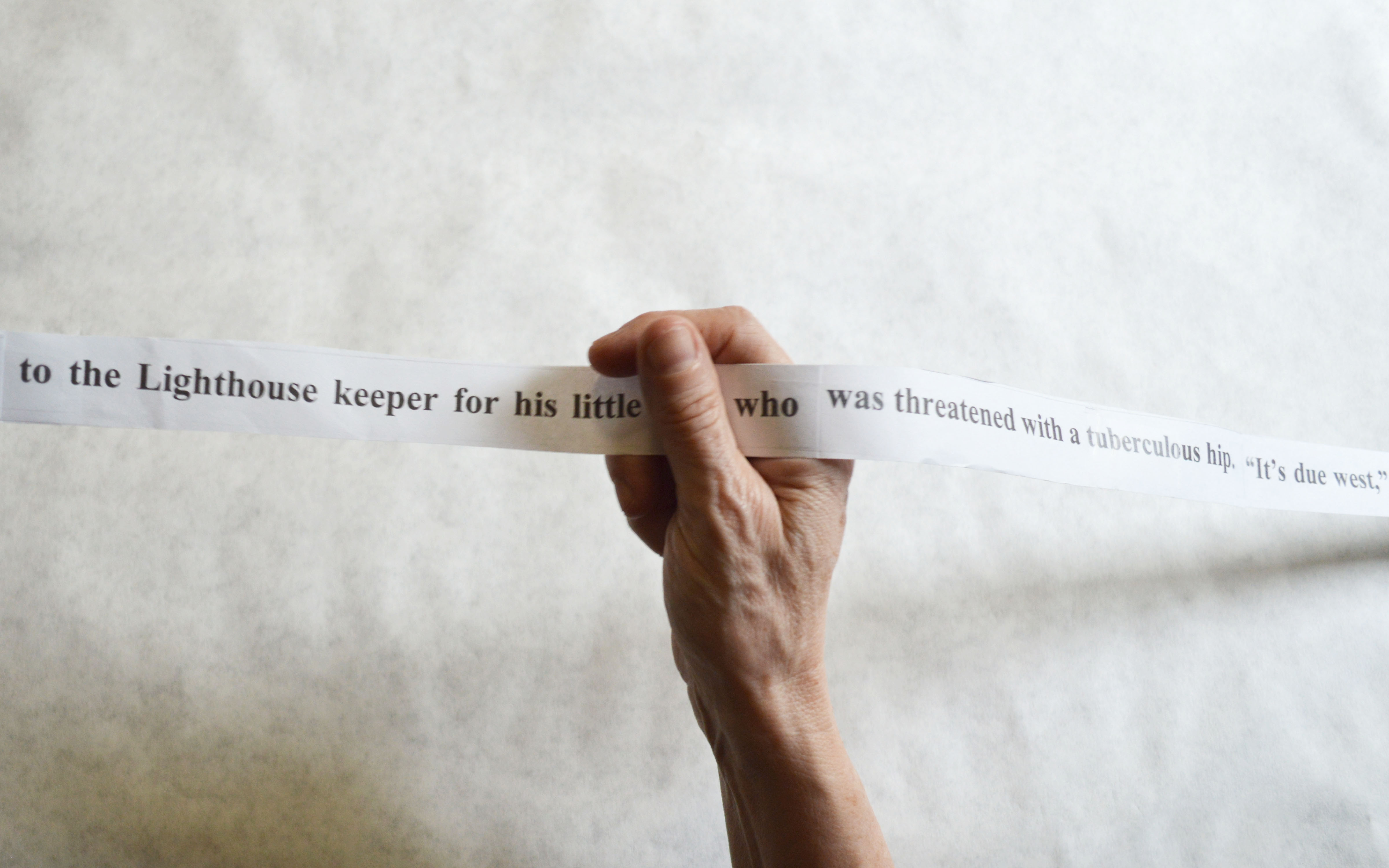 Long strip of paper with words