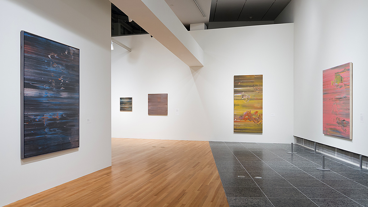 Installation shot of several Jack Whitten paintings in the Wexner Center galleries