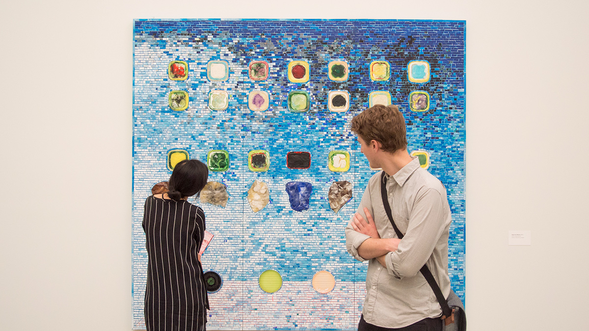 Patrons in front of a Jack Whitten painting in the Wexner Center galleries