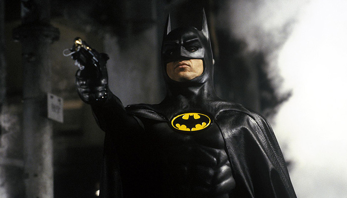 film still of Michael Keaton's Batman/Bruce Wayne in a bat suit
