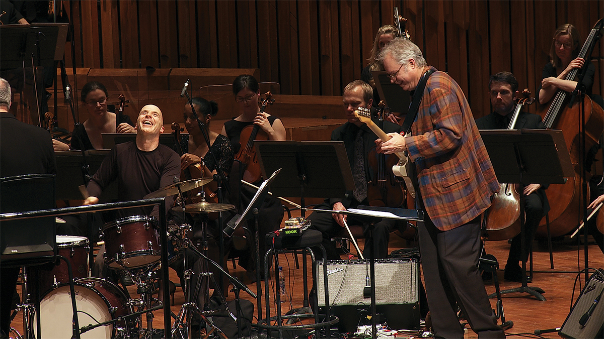 Bill Frisell playing guitar with a full band