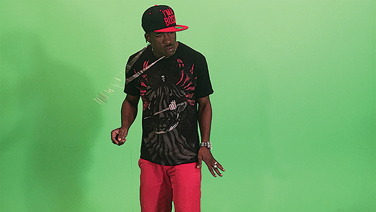 man standing in front of a green screen