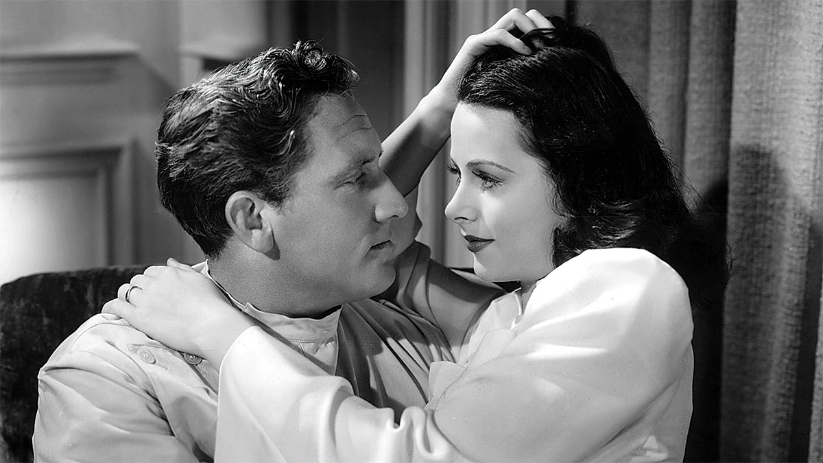 Film still of a man and woman looking deep into each other's eyes.