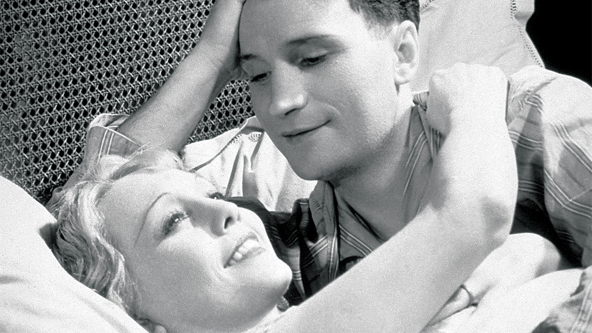close-up of a man and woman lying in bed