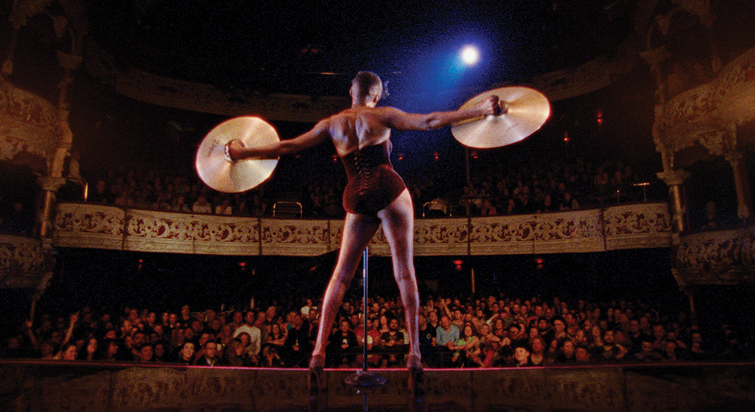 a film still of Grace Jones on stage in front of an audience