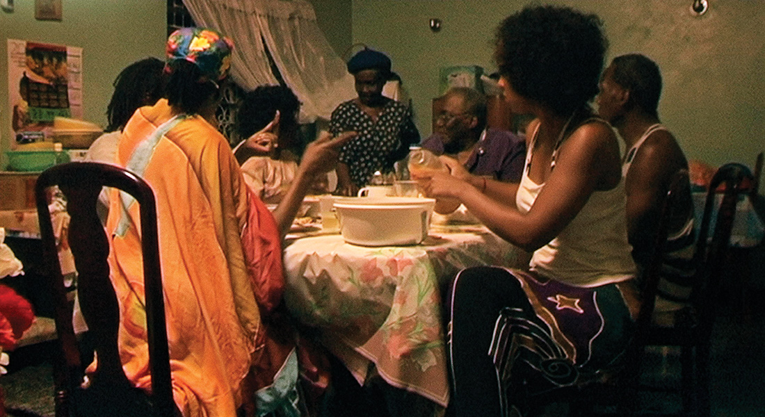 a film still of a family seated around a table