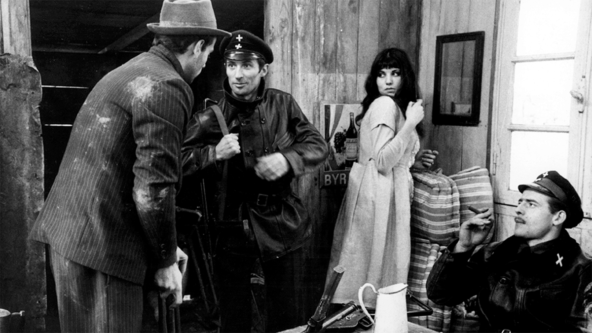 A black and white movie still with three men and a lady