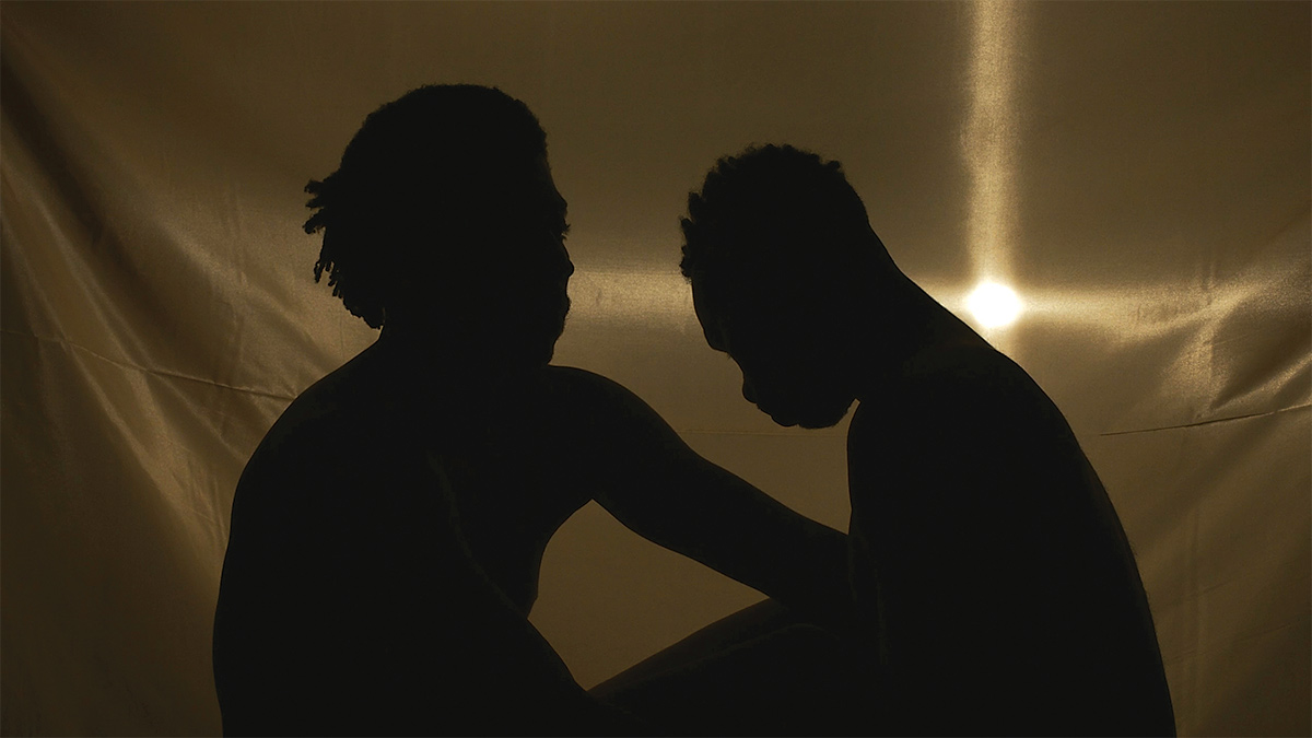 Two figures in silhouette