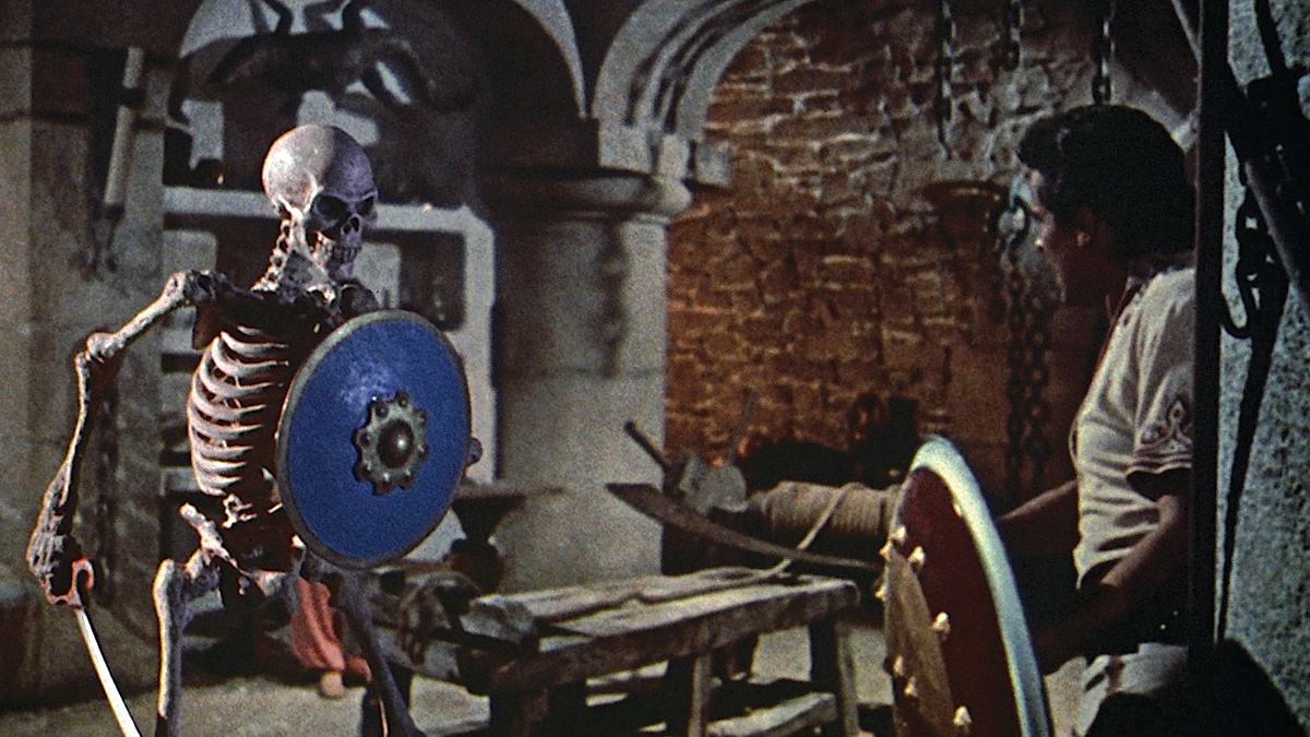 a warrior battles an animated armored skeleton in a dungeon