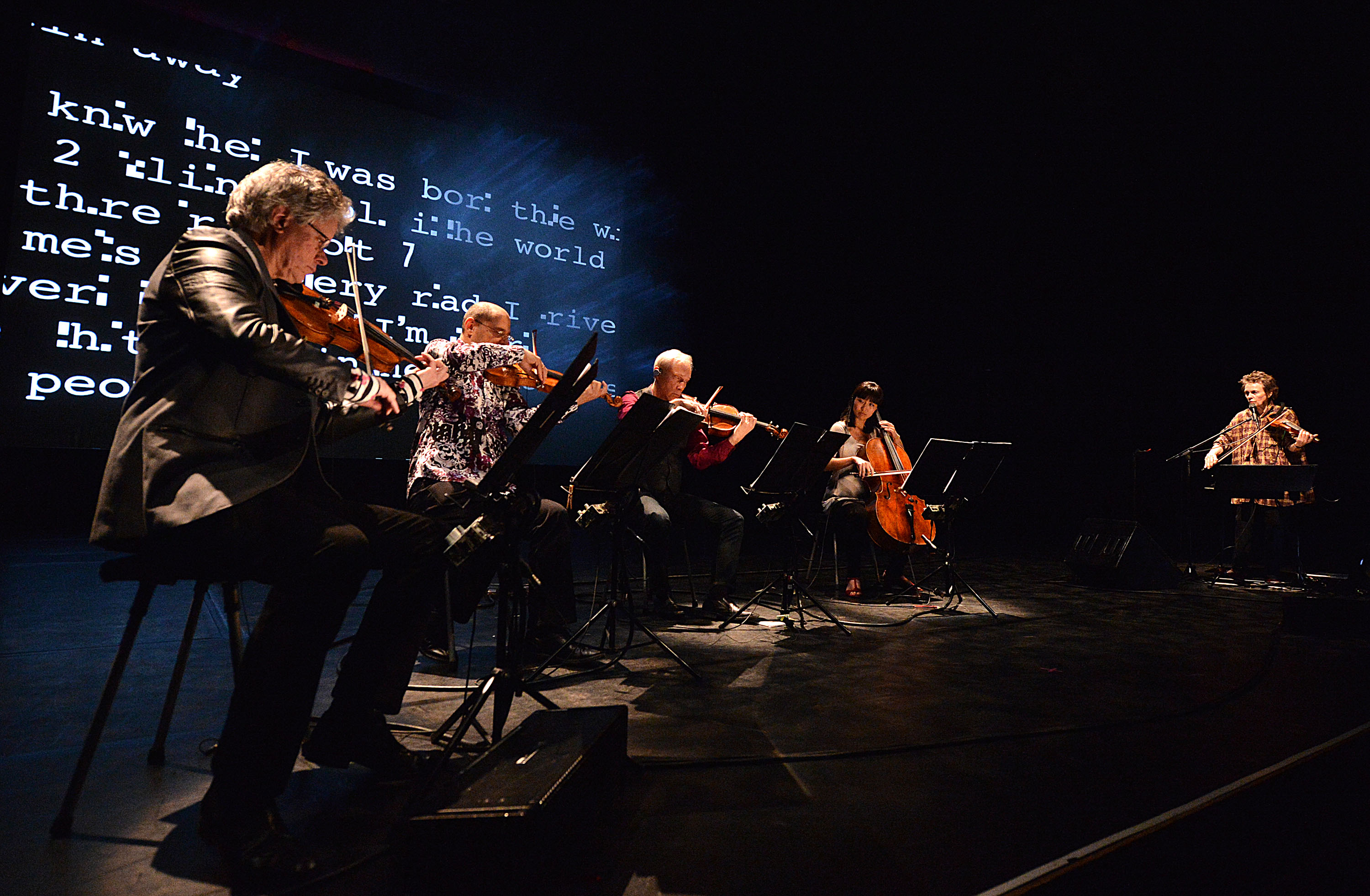 kronos quartet and laurie anderson performing on stage