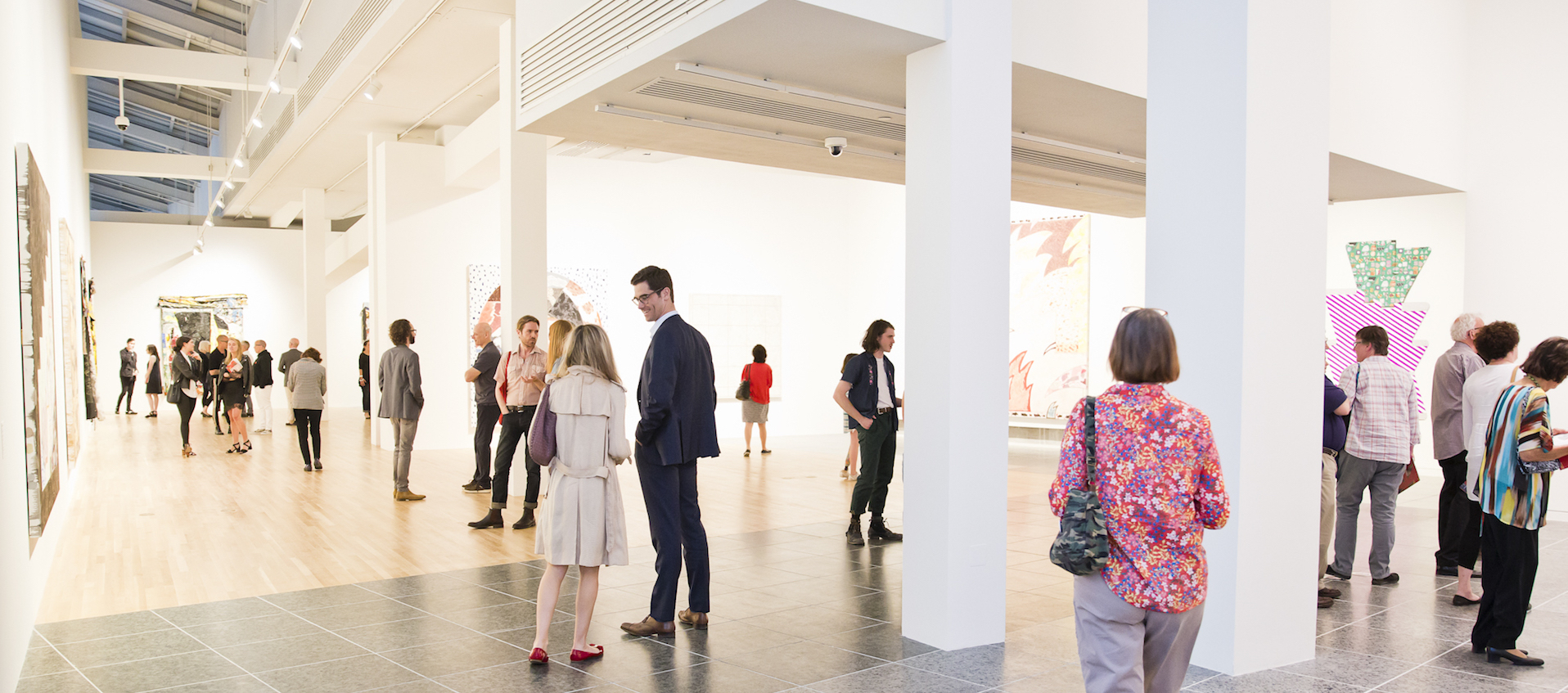 "Image of gallery visitors during the May 18, 2018 preview reception for the Wexner Center for the Arts exhibition ""Inherent Structure."" Photo: Katie Spengler"