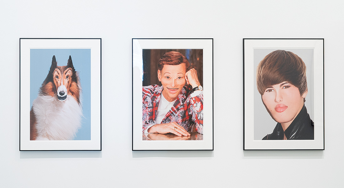 Line up of John Waters artworks including Lassie, a self portrait, and Justin Bieber