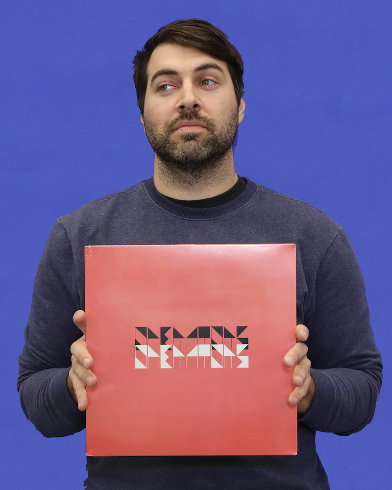 Wexner Center for the Arts Preparator James-David Mericle with an LP album by the Operators for the 2018 holiday gift guide