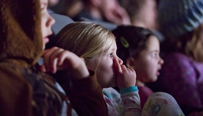 Young children watch a movie in the Wexner Center for the Arts Film/Video Theater during the Zoom: Family Film Festival in December 2017
