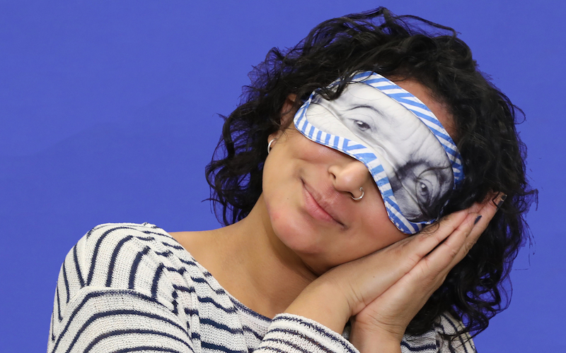 Wexner Center for the Arts Lighting Supervisor Sonia Baidya models the Louise Bourgeois sleep mask by Third Drawer Down for the 2018 holiday gift guide