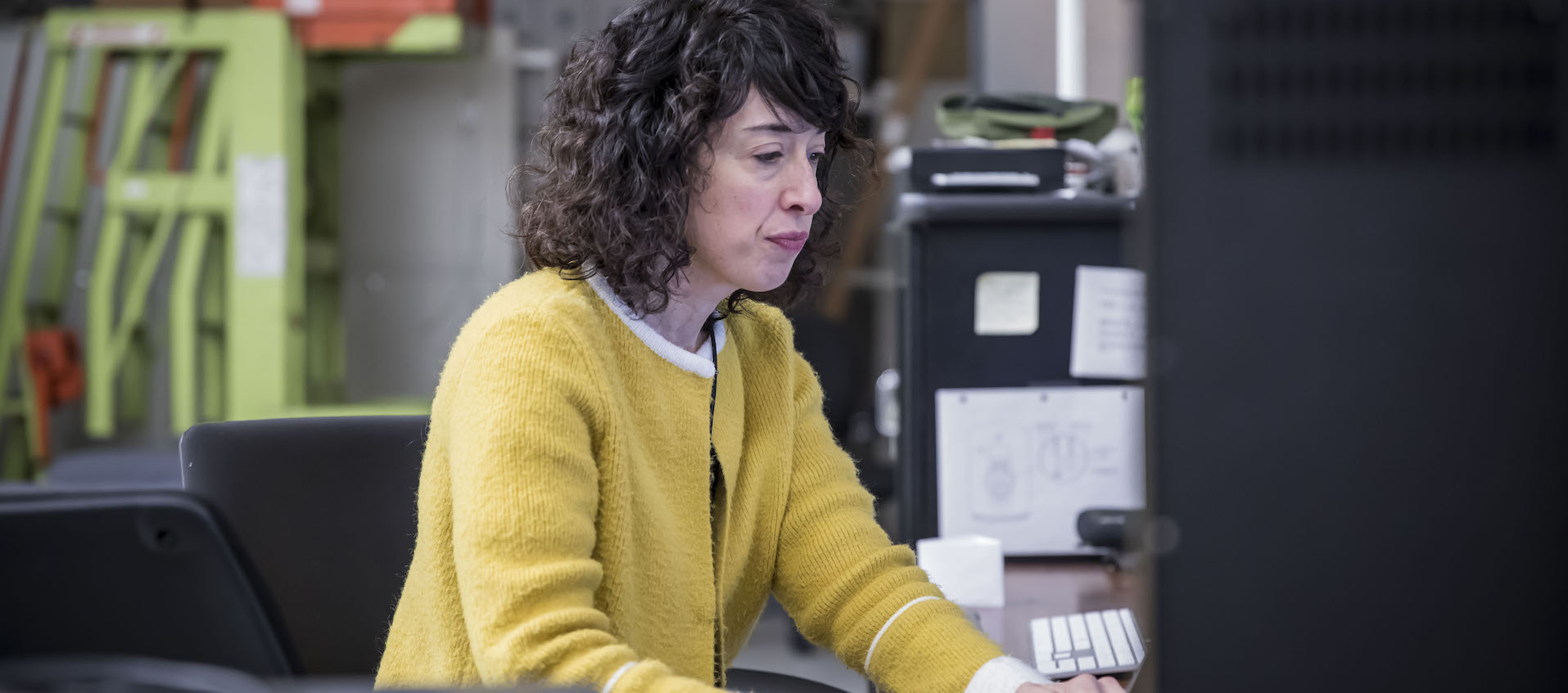 Artist and filmmaker Hope Ginsburg works on her laptop computer in the Wexner Center Film/Video Studio in October 2018.
