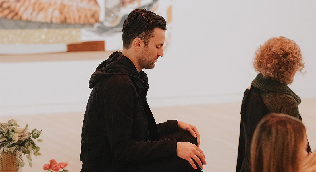 Patrons meditate in the galleries