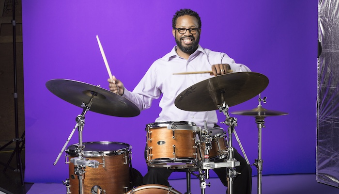 Studio shot of drummer, composer, educator, and activist Mark Lomax II at his drums