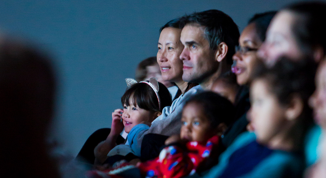 Parents with their children enjoy films at Zoom: Family Film Festival.