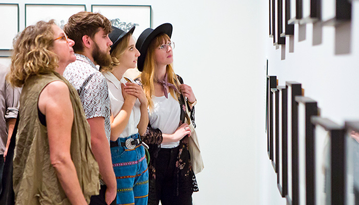 Patrons tour the galleries