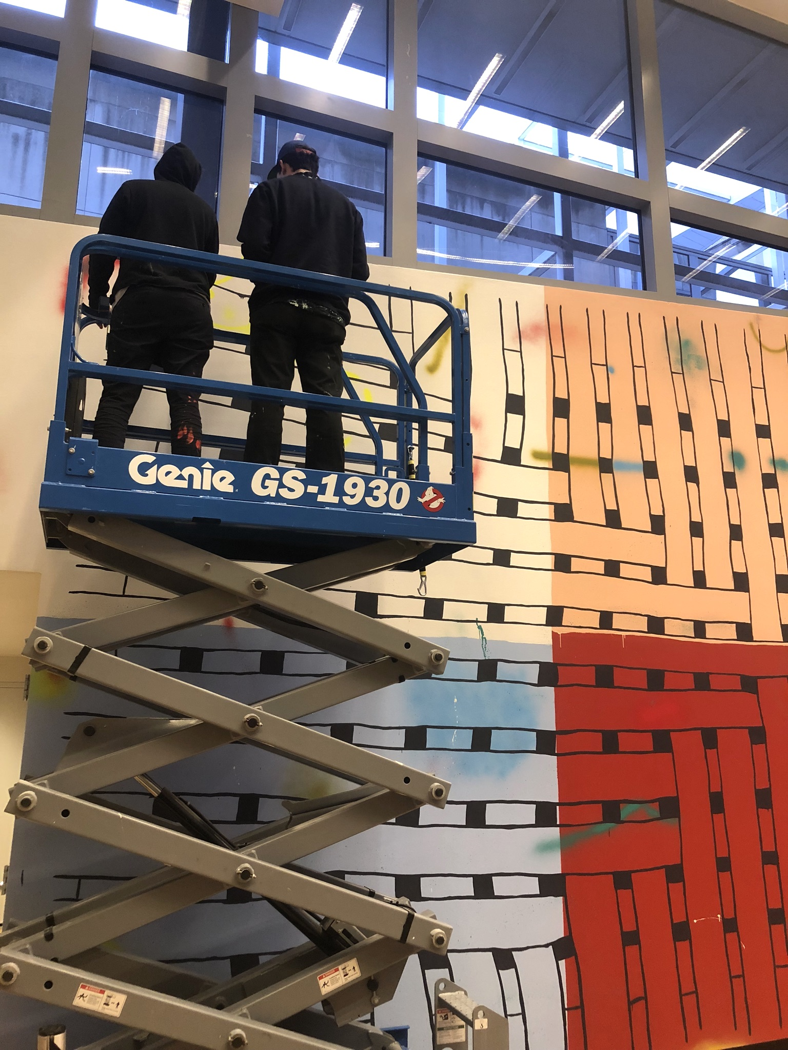 Artists Alicia McCarthy and Oliver Hawk Holden work on the site-specific mural No Straight Lines at the Wexner Center for the Arts at The Ohio State University