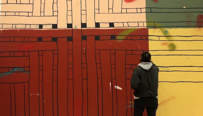 Artists Alicia McCarthy works on the site-specific mural No Straight Lines at the Wexner Center for the Arts at The Ohio State University
