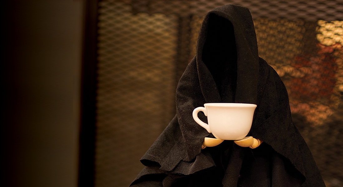 Death holding coffee
