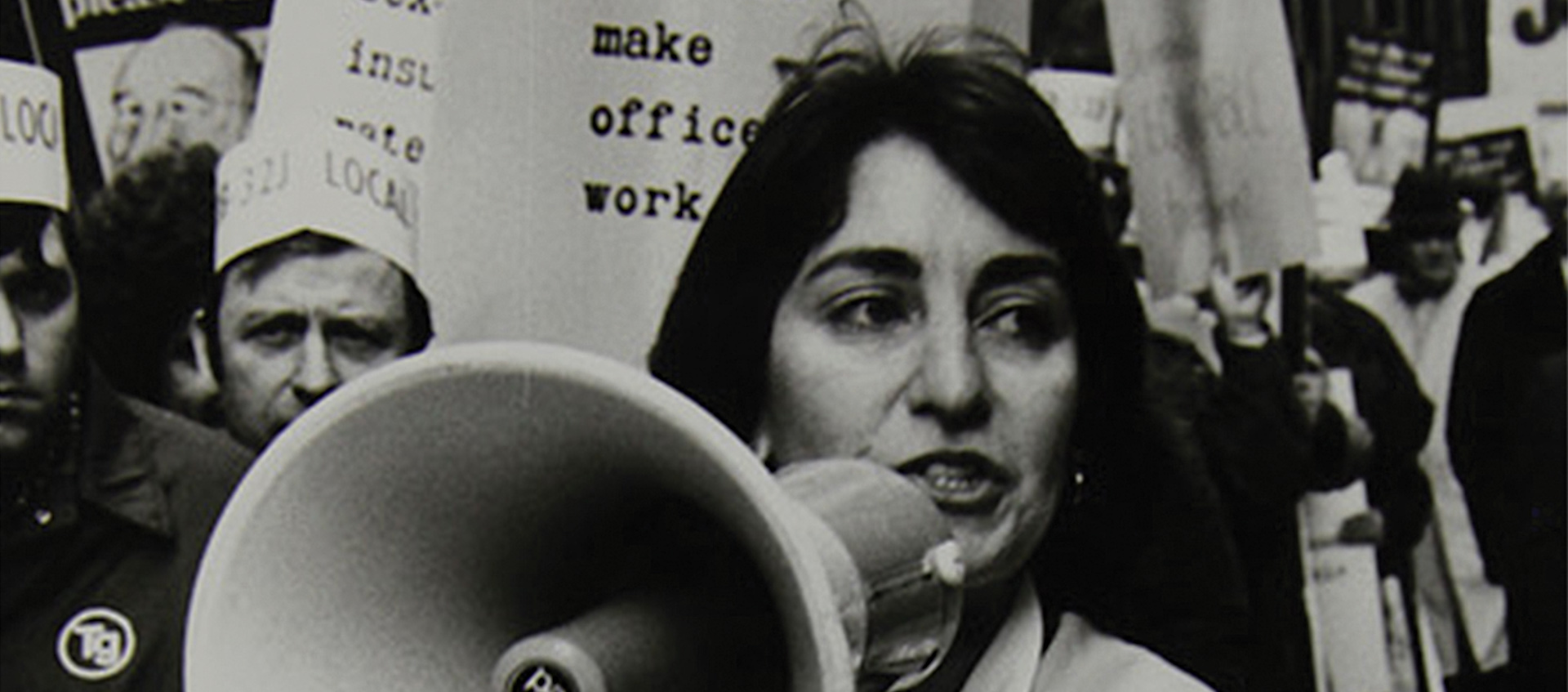 Image of woman with bullhorn from 9to5: The Story of a Movement