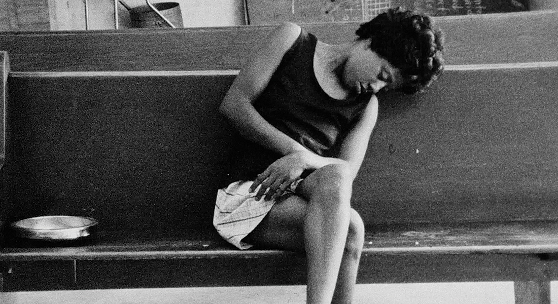 Image of woman asleep on a bench from Methadone: An American Way of Dealing
