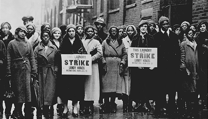 An archival image of striking women laundry workers from the documentary Union Maids