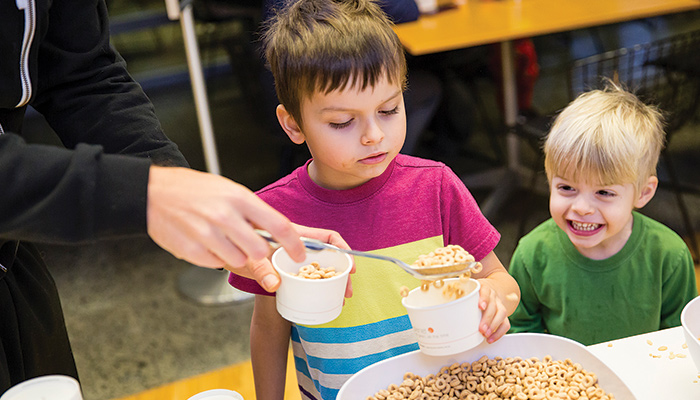 Child being served cereal