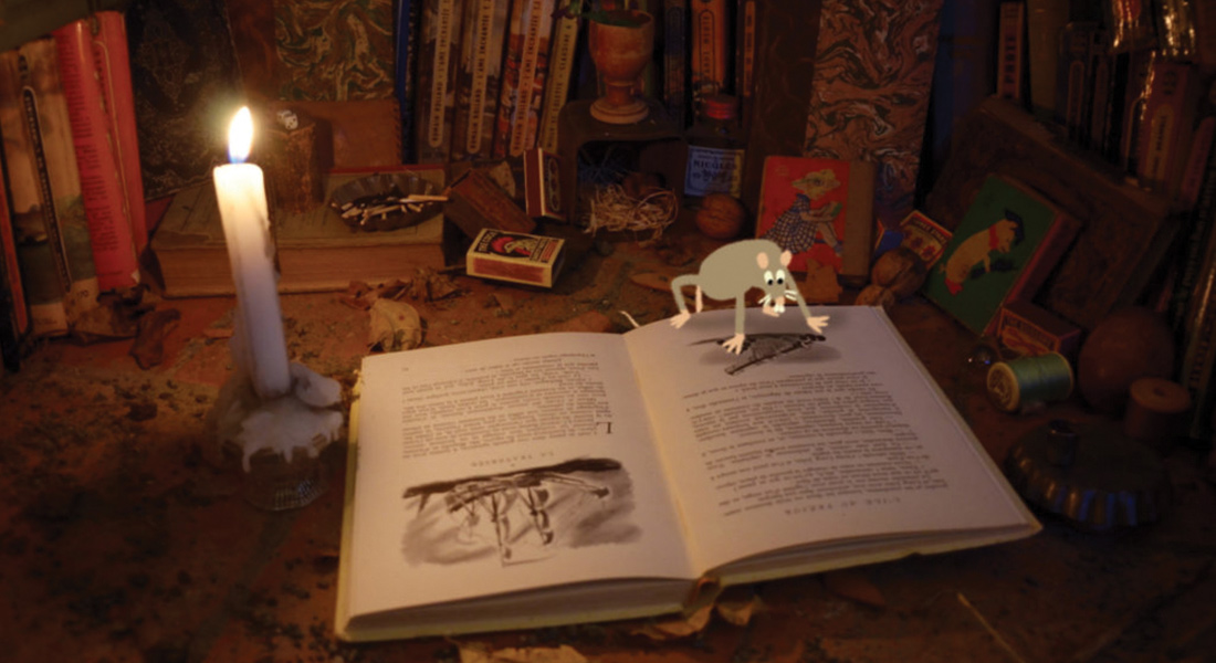 Rat reading book by candlelight