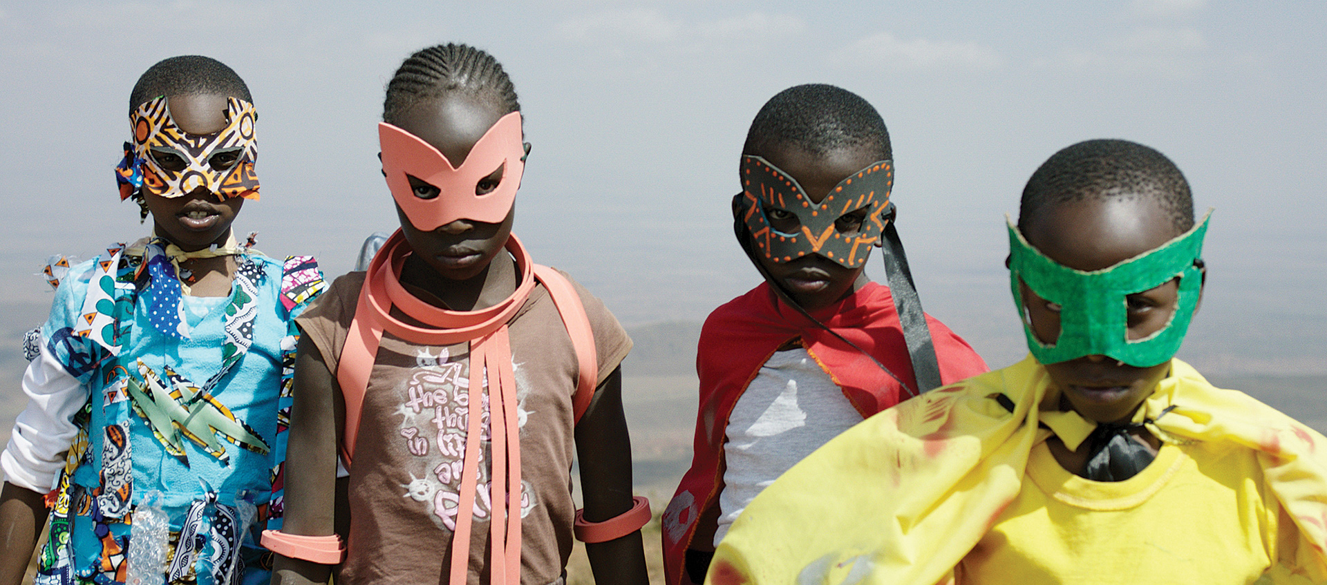 Four young Kenyan children in makeshift masks and superhero costumes, from the film Supa Modo