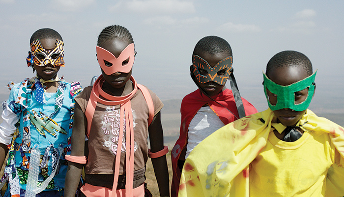 Children dressed in superhero masks and capes
