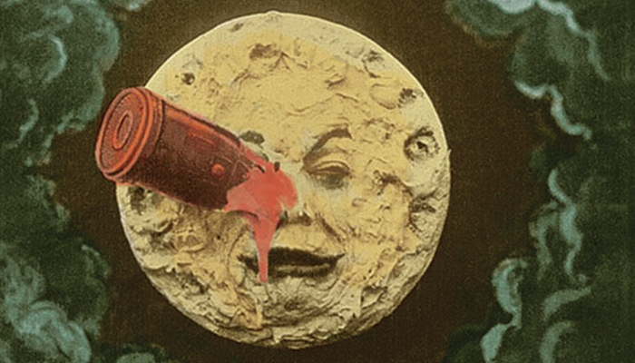 Color image of the man in the moon with a spaceship in his eye from the Georges Melies film A Trip to the Moon
