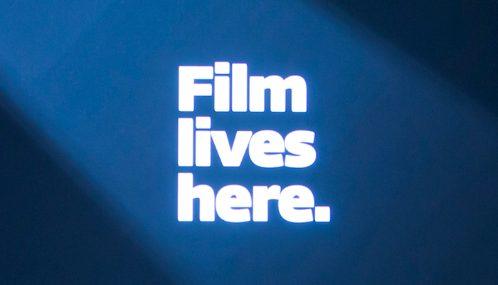 White text on blue background with the Wexner Center Film/Video tagline Film Lives Here