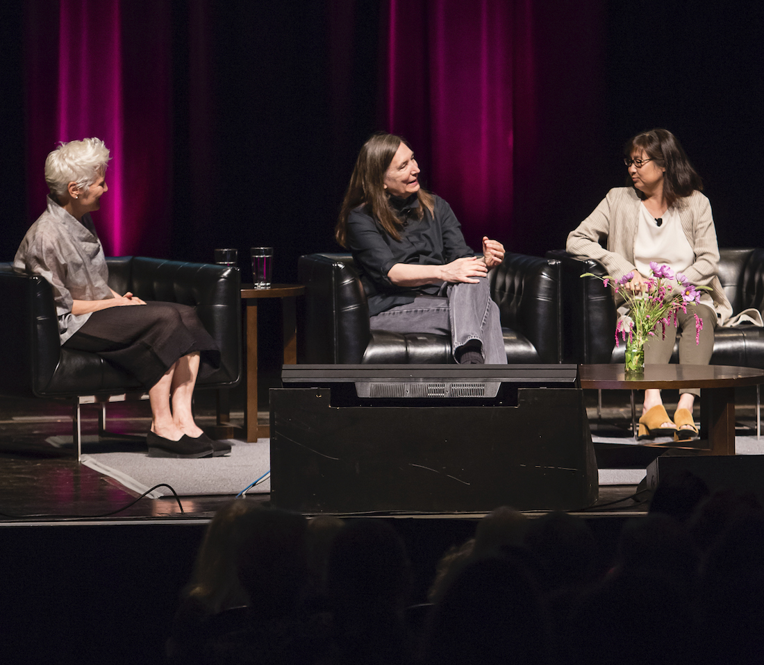 Artists Ann Hamilton, Jenny Holzer, and Maya Lin sitting on the stage of Mershon Auditorium, discussing their work as part of opening events for the fall 2019 exhibition HERE at the Wexner Center for the Arts. Photo by Katie Gentry