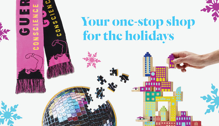 "A pink and black knit Guerilla Girls scarf, a jigsaw puzzle and a building block set against a white background marked with pink and blue snowflakes and the phrase ""your one-stop shop for the holidays"""