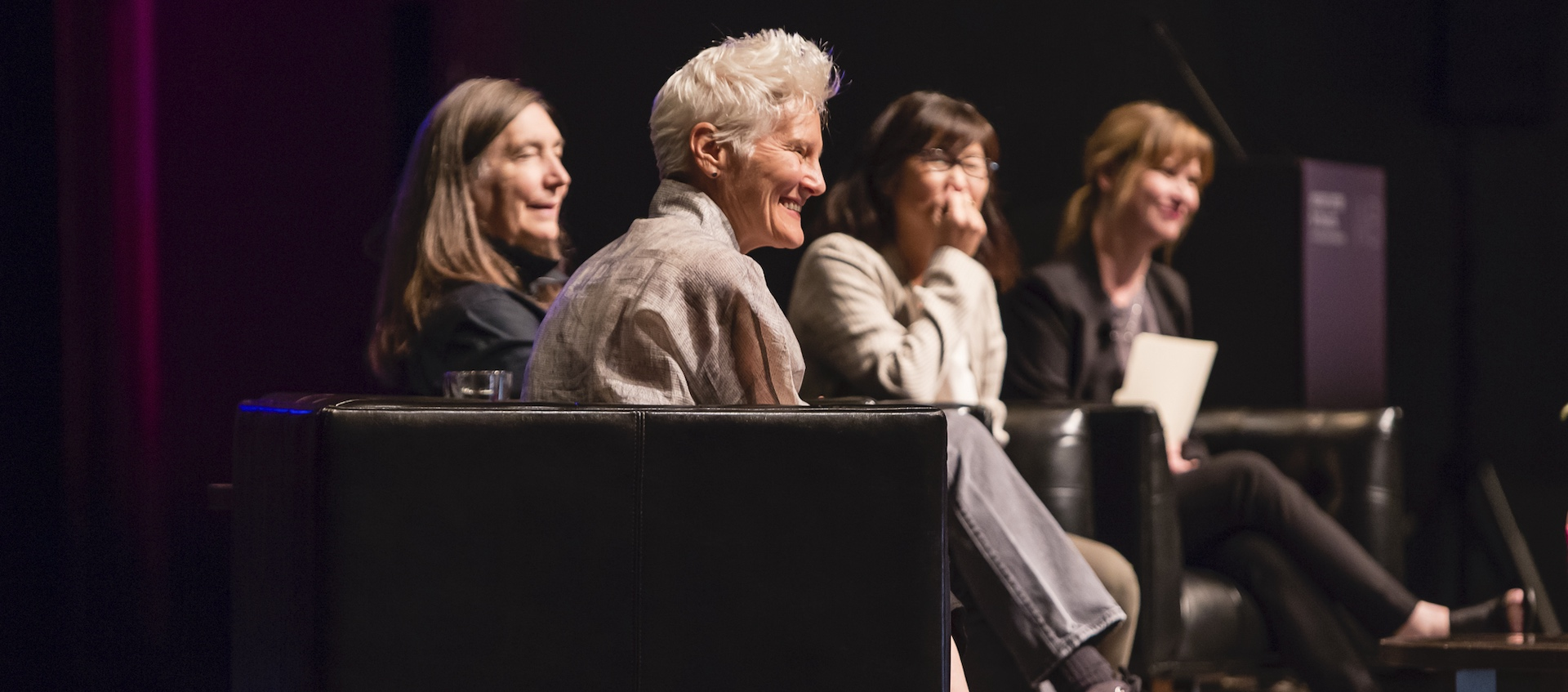 Artists Ann Hamilton, Jenny Holzer, and Maya Lin sitting on the stage of Mershon Auditorium, discussing their work with Wexner Center director Johann Burton as part of opening events for the fall 2019 exhibition HERE at the Wexner Center for the Arts. Photo by Katie Gentry