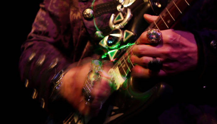 Image of hands playing an electric guitar from the Lori Felker Film Future Language: The Dimensions of VON LMO