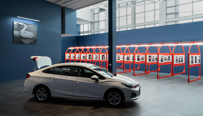 Installation view of the exhibition The Last Cruze by artist LaToya Ruby Frazier, with the last Chevy Cruze to come off the Lordstown, Ohio GM assembly line in the foreground
