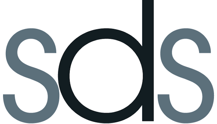"Three letter abbreviated logo for the Society of Disability Studies: a black ""b"" with a gray ""s"" on either side on a white background"